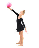 Little gymnast doing exercise with ball Royalty Free Stock Image