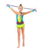 Little gymnast holding a skipping rope over her head royalty free stock photos