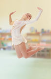 Little gymnast jumping Royalty Free Stock Photography