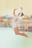 Little gymnast jumping Stock Images