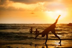 Backflip On A Beach At Sunset stock images