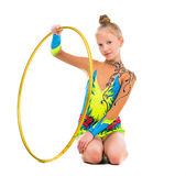 Little gymnast sitting on the floor with hoop Stock Photos