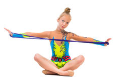Little gymnast sitting on the floor with skipping rope Stock Photos