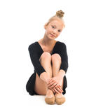 Little gymnast stretching on the floor Stock Image