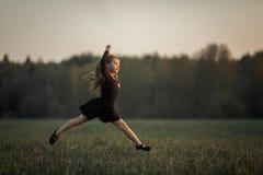 Little gymnastic  girl training outdoor
