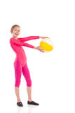 Little gymnastics girl posing with a ball. Royalty Free Stock Photo