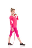 Little gymnastics girl posing with skipping-rope Stock Photo