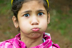 Little gypsy girl child holding breath funny portrait. Little gypsy girl child holding breath funny closeup portrait Royalty Free Stock Photo