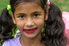 Little gypsy girl with smudged lipstick stock photography