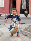 Little gypsy musician plays drum Royalty Free Stock Photos