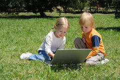 Little hackers. On a glade in park Stock Image
