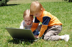 Little hackers on a glade. In park Royalty Free Stock Images