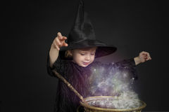 Little halloween witch. With cauldron Royalty Free Stock Image