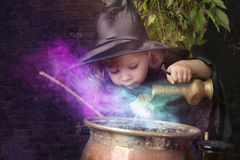 Little halloween witch with cauldron,. Outdoors Royalty Free Stock Image