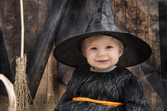 Little halloween witch. Cute little smiling halloween witch with broom Stock Photos