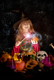 Little Halloween witch pronounced conjure magic words Stock Image