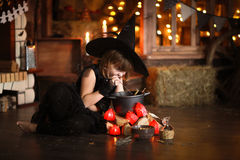 Little Halloween  witch reading conjure above pot   childhood h Stock Photography