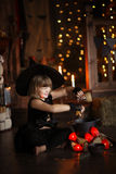 Little Halloween  witch reading conjure above pot   childhood h Stock Image