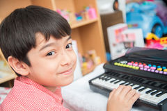 Little hand boy playing small keyboard practice indoor. Little hand boy playing small keyboard practice stock photos