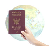 Little hand hold passport, travel concept. Royalty Free Stock Photo