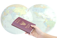 Little hand hold passport, travel concept. Stock Photo