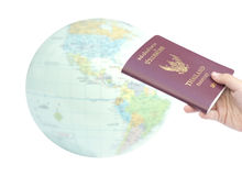 Little hand hold passport, travel concept. Stock Image