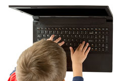 Little hand and keyboard notebook Stock Images