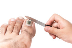 Little Hand Use A Nail File To Clean Toenail Royalty Free Stock Photos
