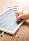 Little hand writing on a chalkboard Royalty Free Stock Images