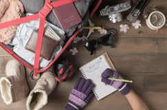 little hand writing winter trip plan with accessories travel items stock image