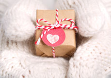 Little handmade gift box in hands with gloves Royalty Free Stock Photography