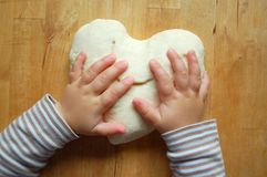 Little hands baking a heart Royalty Free Stock Images