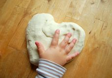 Little hands with dough Royalty Free Stock Photo