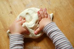 Little hands with dough Royalty Free Stock Photography