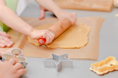 Little hands making the gingerbread cookies Royalty Free Stock Photography