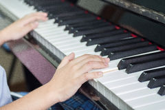 Little hands on piano Stock Image