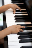 Little hands playing on the piano. Children hands playing on the piano Stock Photo