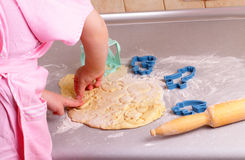 Little hands prepare biscuits in the kitchen Royalty Free Stock Photos