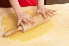 Little hands rolling out dough Royalty Free Stock Photo