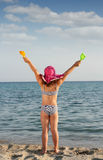 Little with hands up on beach summer scene Stock Photos