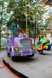 Little handsome boy rides in car of carousel in amusement park Royalty Free Stock Images