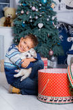 Little handsome boy sitting with Husky puppies Stock Image