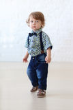 Little handsome curly boy in jeans Stock Images