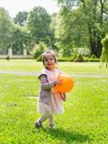 Little handsome girl in the park Royalty Free Stock Photography