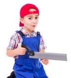 Little handyman showing saw cutting hazard Stock Photos