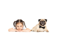 Little happy adorable girl with pug dog Royalty Free Stock Images