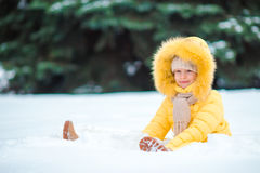 Little happy adorable girl in snow sunny winter day Stock Photo