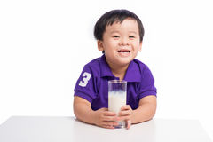 Little happy asian boy with glass of milk isolated on white back stock photos