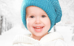 Little happy baby child girl in white hat in  winter Royalty Free Stock Photos