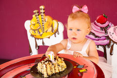 Little happy baby girl celebrating first birthday. Kid and her first cake on party. Childhood. Royalty Free Stock Image